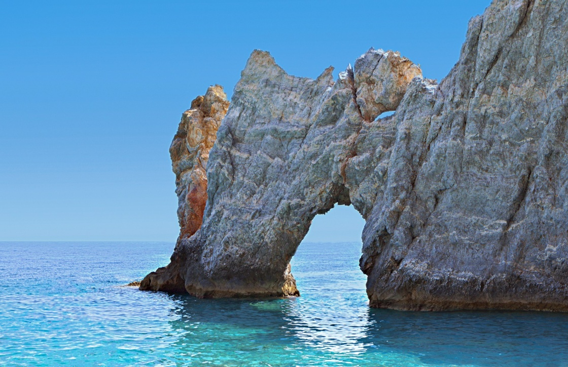 Lalaria beach and the famous holey rock at Skiathos island in Greece